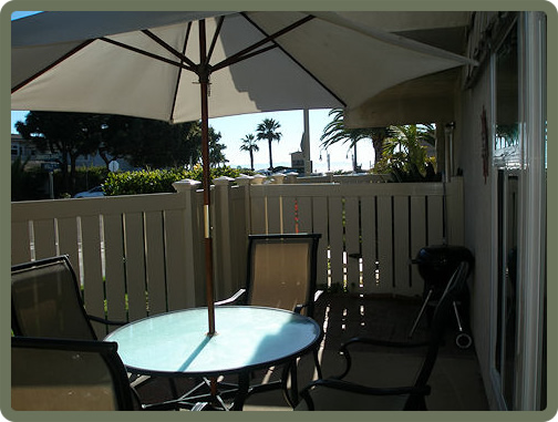 Patio faces Ash Avenue near the corner of Sandyland. Beach access from the patio and views of the ocean.