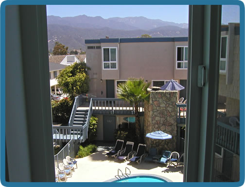 View of the pool and mountains from the second bedroom